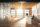 Modern sunny wood style reception hall with big windows
